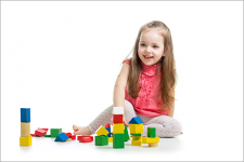 Girl playing with toy blocks